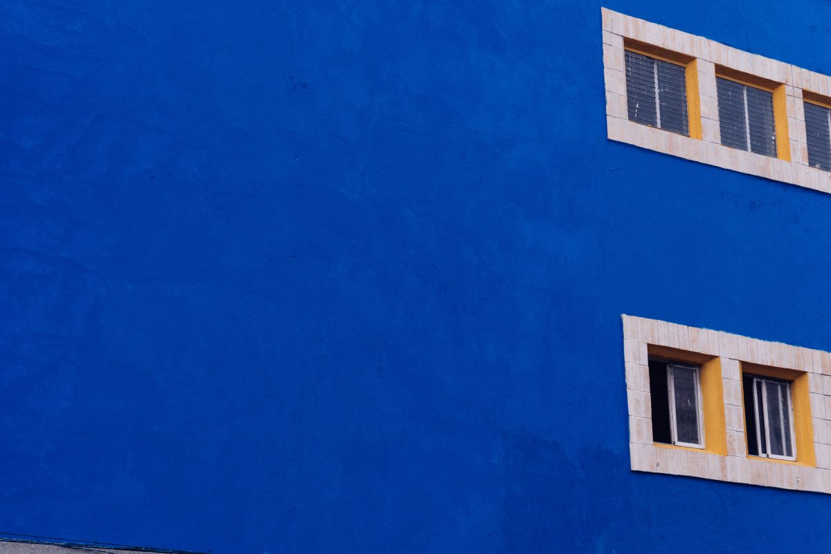 Blue wall with small windows